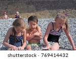 siblings have fun time on the... | Shutterstock . vector #769414432