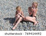 siblings have fun time on the... | Shutterstock . vector #769414492