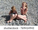 siblings have fun time on the... | Shutterstock . vector #769414942