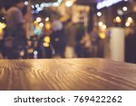 wood table top with blur of... | Shutterstock . vector #769422262