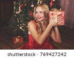 a beautiful blonde woman in a... | Shutterstock . vector #769427242