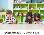 diversity kid lay down on floor ... | Shutterstock . vector #769445476