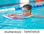 boy practice swimming | Shutterstock . vector #769476925