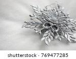 silver snowflake in macro... | Shutterstock . vector #769477285