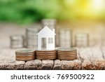 house model on coins stack for... | Shutterstock . vector #769500922