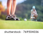 putter walking though hit or... | Shutterstock . vector #769504036