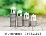 paper house on coins stack for... | Shutterstock . vector #769511815