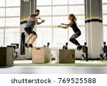 man and woman jumping on boxes...   Shutterstock . vector #769525588
