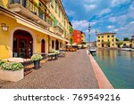 lazise colorful harbor and... | Shutterstock . vector #769549216