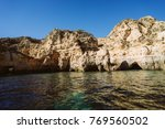 caves and cliffs in the ocean | Shutterstock . vector #769560502