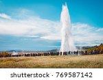 a crowd admiring an eruption of ... | Shutterstock . vector #769587142