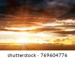 Storm Sky And Sun Rays With...