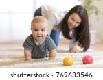 funny crawling baby infant boy... | Shutterstock . vector #769633546