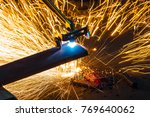 factory worker cutting metal... | Shutterstock . vector #769640062