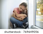 little sad girl with toy at... | Shutterstock . vector #769649056