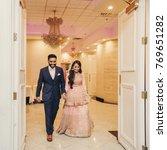 indian groom in classy western... | Shutterstock . vector #769651282