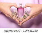hands of young woman with... | Shutterstock . vector #769656232