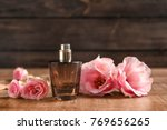 bottle of perfume with flowers... | Shutterstock . vector #769656265