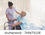 woman caregiver and elderly... | Shutterstock . vector #769673128