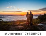 young couple standing on top of ...   Shutterstock . vector #769685476