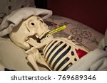 the skeleton with fever lies in ... | Shutterstock . vector #769689346