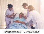 elderly patient lying on bed... | Shutterstock . vector #769694365