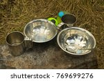 aluminum tableware set on stone | Shutterstock . vector #769699276