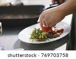 chef serves steak in restaurant | Shutterstock . vector #769703758