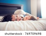 a mother and her son child... | Shutterstock . vector #769709698