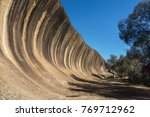 wave rock  a natural rock... | Shutterstock . vector #769712962
