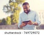 modern gadget. handsome... | Shutterstock . vector #769729072