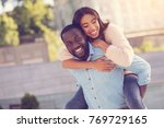 having fun. joyful nice strong... | Shutterstock . vector #769729165