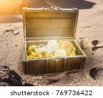 treasure chest filled with... | Shutterstock . vector #769736422