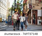 group of friends crossing urban ... | Shutterstock . vector #769737148