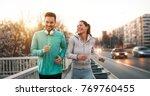 couple jogging outdoors | Shutterstock . vector #769760455