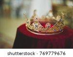 golden crowns lying on the... | Shutterstock . vector #769779676