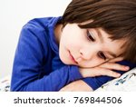 Small photo of Child affected by Asperger's syndrome in the solitude of his room