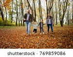 happy caucasian family of mom... | Shutterstock . vector #769859086