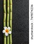 Frangipani flower and bamboo on ...