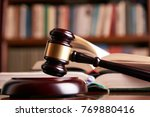 law gavel or judge mallet on a... | Shutterstock . vector #769880416