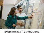 couple choosing tiles in... | Shutterstock . vector #769892542