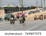 people on motorcycles with... | Shutterstock . vector #769897375