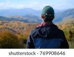a single man wearing grey coat... | Shutterstock . vector #769908646