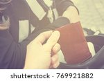 thief stealing the wallet from... | Shutterstock . vector #769921882