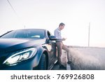 young man phone poses with his... | Shutterstock . vector #769926808