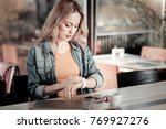 checking time. serious young... | Shutterstock . vector #769927276