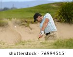Golfer Plays A Sand Trap Shot...
