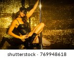 amazing pole dancer posing in a ... | Shutterstock . vector #769948618