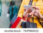 closeup of woman in yellow... | Shutterstock . vector #769980022