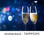 two champagne glasses ready to... | Shutterstock . vector #769995292